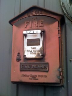 old firbox on side of building
