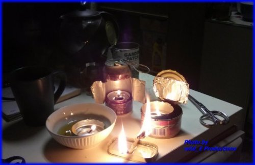 kudlich lit in the front, Veggy, Veggie oil lamps, floating candles, Hurricane candles, Hurricane Lamps, improvised lamps, vegetable oil lamps, made from pop cans, tuna cans, salmon cans, natural fibre jute string, natural fiber jute string.